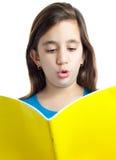 Scrittura latina della ragazza su un taccuino isolato su bianco Fotografia Stock Libera da Diritti