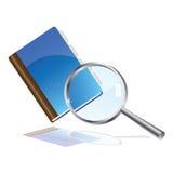 Scrittura-libro e magnifier Fotografie Stock
