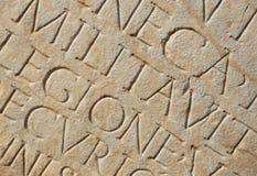 Scrittura romana come priorità bassa Immagini Stock
