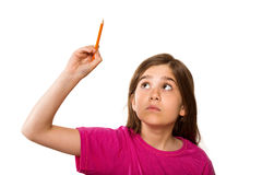Scrittura sveglia dell'allievo con la matita Fotografia Stock Libera da Diritti