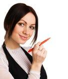 Scrittura sveglia della donna di affari con un indicatore Immagine Stock