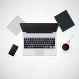 Scrivania con il computer portatile Fotografie Stock
