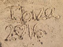 Scrivendo nella sabbia di un Ibiza& x27; spiaggia di s Fotografia Stock Libera da Diritti