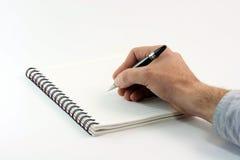 Scrivendo sul taccuino fotografia stock libera da diritti