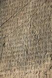 Scrivendo sulla parete di pietra della città antica di T Fotografie Stock Libere da Diritti