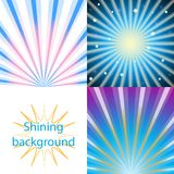 Scroll on a background of sunlight. Set of blue  shining backgrounds with sun rays and stars Stock Photography