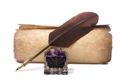 Scroll and fountain pen with feather near inkstand isolated on white Royalty Free Stock Photos
