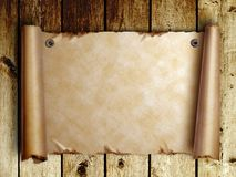 Scroll of old pape on wooden boards Royalty Free Stock Image