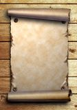 Scroll of old paper on wooden boards. Scroll of old paper is attached with nails on wooden boards Stock Photography