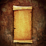 Scroll of old parchment. On grunge wall Royalty Free Stock Photo
