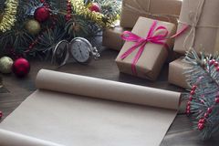 Scroll of old parchment Christmas gifts Stock Photo