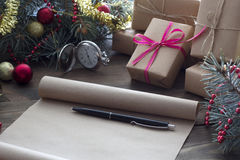Scroll of old parchment and pen, Christmas gifts, Royalty Free Stock Photography