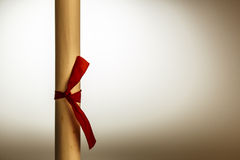 Scroll of paper. Retro rolled paper on the old wooden table Royalty Free Stock Photography