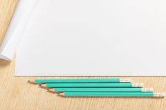 Scroll of paper with pencils. Stock Photography