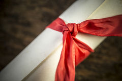 Scroll of paper. Retro rolled paper on the old wooden table Stock Image