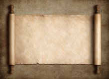 Ancient scroll parchment over old paper background stock photos