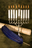 Scroll and quill. Jewish hanukkah candle-holder, scroll and blue quill