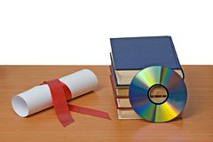 Scroll with red ribbon and books Royalty Free Stock Photo