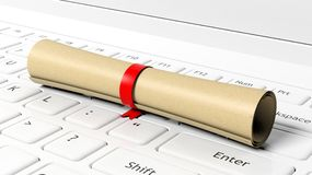 Scroll with red ribbon on laptop Stock Images