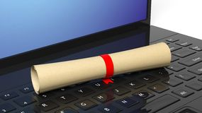 Scroll with red ribbon on laptop Royalty Free Stock Images