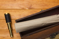 Scroll and telescope in the old box Stock Photography