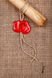 Scroll with wax seal stamp on burlap Stock Image