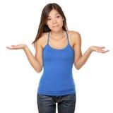 Scrollare le spalle donna in dubbio Immagine Stock Libera da Diritti