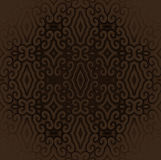 Scrolled antique diamond pattern dark brown centered and blurred Royalty Free Stock Images