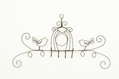 Scrolled wire wall hanging with two birds Royalty Free Stock Images