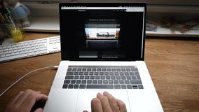 Scrolling Apple Website on 2018 MacBook Pro 15 Safari browser. Paris, France - circa 2018: Man hands POV scrolling Apple Website on MacBook Pro 15 Safari browser stock footage