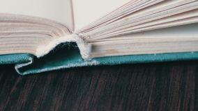 Scrolling a Book in Macro. Turning the pages of an old book close-up.Book pages turning stock video