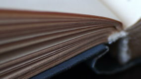 Scrolling a Book in Macro. Turning the pages of an old book close-up.Book pages turning stock footage
