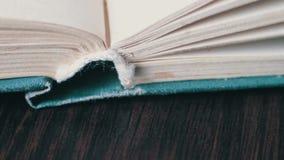 Scrolling a Book in Macro stock video