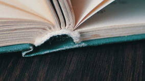 Scrolling a Book in Macro. Turning the pages of an old book close-up.Book pages turning stock video footage