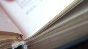 Scrolling a Book in Macro stock footage