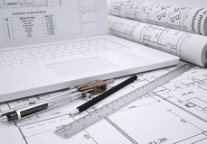 Scrolls architectural drawings and laptop Royalty Free Stock Image