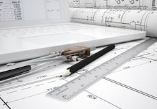 Scrolls architectural drawings and laptop Royalty Free Stock Images