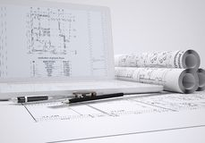 Scrolls architectural drawings and laptop. Architect concept Stock Images