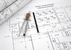 Scrolls architectural drawings and tools. Architect concept Royalty Free Stock Photo