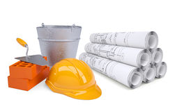 Scrolls of architectural drawings and work tools Stock Image