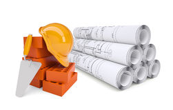 Scrolls of architectural drawings and work tools Stock Photos