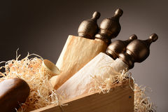 Scrolls and Artifacts in Wooden Crate Stock Photo
