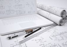 Scrolls Engineering Drawings And Laptop Stock Photo