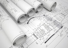 Scrolls of engineering drawings and glasses on Stock Photo