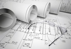 Scrolls of engineering drawings and glasses on Stock Image