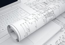 Scrolls engineering drawings and laptop Stock Images