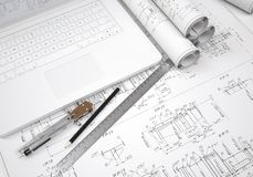 Scrolls engineering drawings and laptop Stock Image