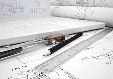 Scrolls engineering drawings and laptop Royalty Free Stock Image