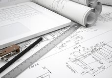 Scrolls engineering drawings and laptop Royalty Free Stock Photos
