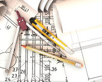 Scrolls engineering drawings and tools. Stock Photo